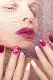 Pink cherry nail design. Pink cherry nail design for nail glitter different shapes on the girl with the Burgundy lips royalty free stock images