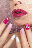 Pink cherry nail design . Pink cherry nail design for nail glitter different shapes on the girl with the Burgundy lips stock photos
