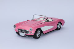 Pink Chevrolet Corvette. Model of pink Chevrolet Corvette (1957) viewed from the front with white background Royalty Free Stock Photos