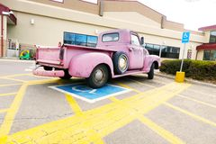 Pink chevy truck memorabilia parked. Pink truck old fashioned memorabilia Royalty Free Stock Image