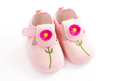 Pink child's booties. Pink toddler's shoes with tamboured flowers stock image