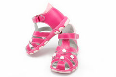 Pink child's sandals isolated on white Royalty Free Stock Images