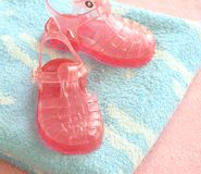 Pink children's footwear on blue  towels Royalty Free Stock Photo