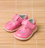 Pink children's shoes #3 on bamboo Royalty Free Stock Photo