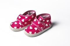The pink children's sneakers isolated on a white background . Children's shoes. Shoes for girl royalty free stock photos