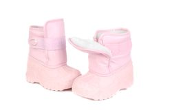 Pink children snow boots. Royalty Free Stock Image