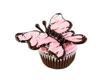 Pink Chocolate Butterfly Cupcake. Delicious cupcake decorated with pink chocolate butterfly isolated on white background Stock Images