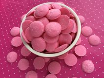 Pink Chocolate Candy Melts on pink polka dots  Background Royalty Free Stock Images