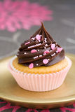 Pink chocolate cupcake. Served on a gold plate Stock Photos