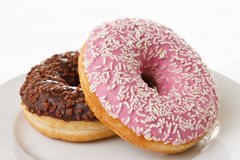 Pink and chocolate donuts with sprinkles Stock Images