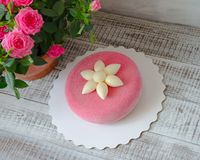 Pink chocolate velour cake decorated with flower. Pink chocolate velour cake decorated with a flower Stock Photos