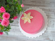 Pink chocolate velour cake decorated with flower. Pink chocolate velour cake decorated with a flower Stock Photo