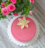 Pink chocolate velour cake decorated with flower. Pink chocolate velour cake decorated with a flower Stock Images