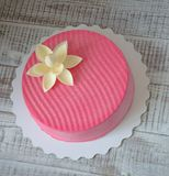 Pink chocolate velour cake decorated with flower. Pink chocolate velour cake decorated with а flower Stock Image