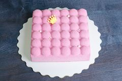 Pink chocolate velour mousse cake with pearls. A pink chocolate velour mousse cake with pearls Stock Image