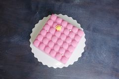 Pink chocolate velour mousse cake with pearls. A pink chocolate velour mousse cake with pearls Stock Images