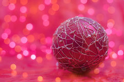 Pink christmas ball on bokeh background royalty free stock image