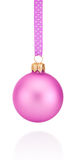 Pink Christmas ball hanging on ribbon Isolated on white backgrou Royalty Free Stock Images