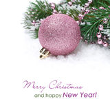 Pink christmas ball and spruce branches, isolated Royalty Free Stock Photography
