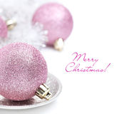 Pink Christmas ball and tinsel close-up, isolated. On white stock image