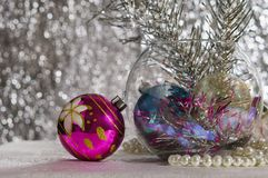 Pink Christmas ball and the vase. Pink Christmas ball and vase with tinsel and balls on the silver background Stock Image