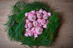 Pink christmas balls on fir branches. Free space for text. Studio photography. Object shooting Royalty Free Stock Photos