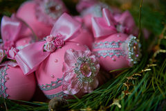 Pink christmas balls on fir branches. Studio photography. Object shooting Royalty Free Stock Photos