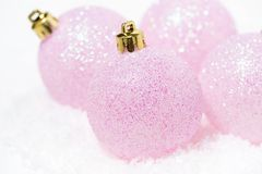 Free Pink Christmas Balls In The Snow On A White Background, Closeup Royalty Free Stock Image - 125944516