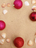 Pink christmas balls in sand Stock Image