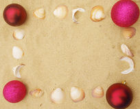 Pink christmas balls in sand Royalty Free Stock Photo