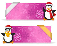 Pink Christmas Banners with Penguin. Two pink Christmas banners with a cute cartoon penguin smiling and greeting, snowflakes and a ribbon. Eps file available Royalty Free Stock Photos