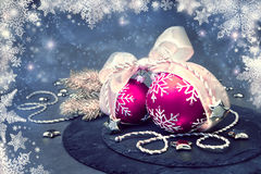 Pink Christmas baubles on abstract winter background Royalty Free Stock Images