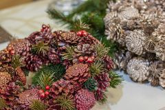 Pine in Pink Christmas door wreath. decoration made of pine , fir and berries.Selected focus. Pink Christmas door wreath decoration made of pine and fir cones royalty free stock image