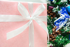 Pink christmas gifts front of a christmas tree Stock Photo