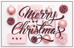 Pink christmas gifts isolated on white background. Wrapped xmas boxes, christmas ornaments, baubles and pine cones. royalty free stock photos