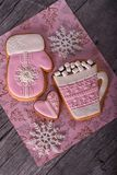 Pink Christmas gingerbreads on the grey wooden background Royalty Free Stock Photography