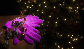 Pink Christmas gloves Stock Photos