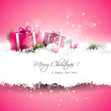 Pink Christmas greeting card. With gift boxes and branches in snow and with place for text Royalty Free Stock Photography