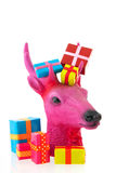 Pink Christmas reindeer with presents Stock Image