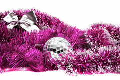 Pink Christmas tinsel with silver ball and bow Royalty Free Stock Image