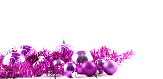 Pink Christmas tree balls and decorations isolated Stock Images
