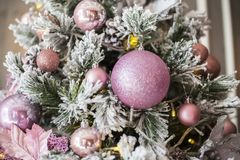 Pink Christmas tree decorations in stock image