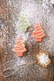 Pink christmas tree homemade sweets  in rustic style on wooden d Stock Photos