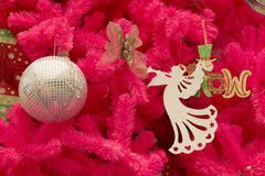Pink Christmas tree with ornaments. Royalty Free Stock Photos