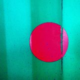 Pink circle on green wall Stock Photography