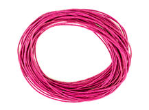 Pink circular loop of bright colorful rope twine isolated agains Royalty Free Stock Photos