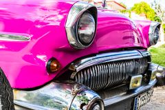 Pink classic american car in Cuba royalty free stock images