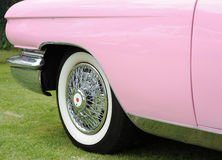 Pink classic car. Close up of pink classic cars wheel and bodywork Royalty Free Stock Photos