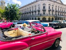 Pink classic Cuban vintage car. American classic car on the road in Havana, Cuba. stock image
