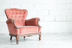 Pink classical Armchair. Pink classical style Armchair sofa couch in vintage room Royalty Free Stock Photo